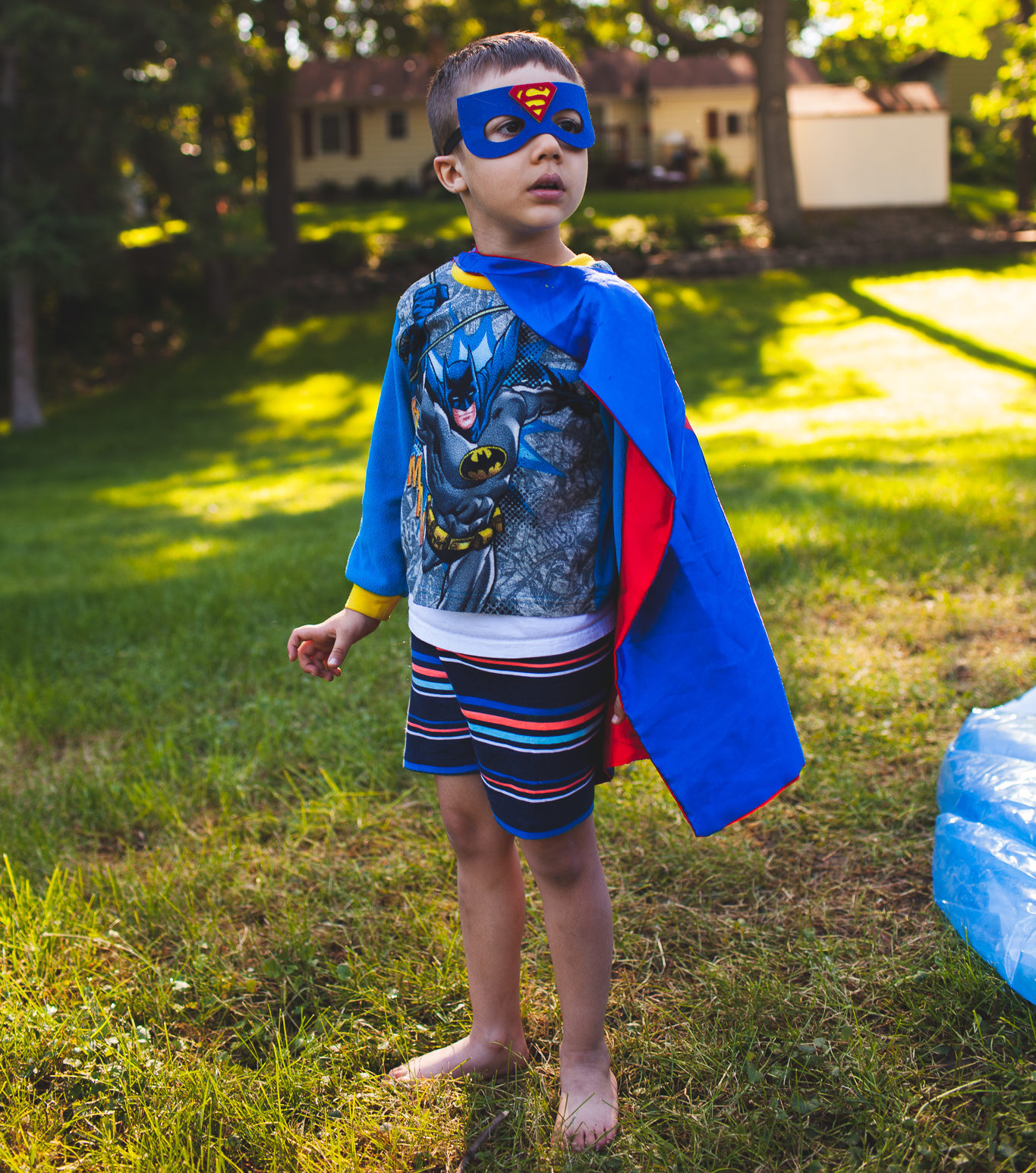 Boy dressed as Batman and Superman